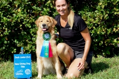 MFGRC Secretary Michele Throm and Bella earning her NADD/AKC Junior Dock Diving title